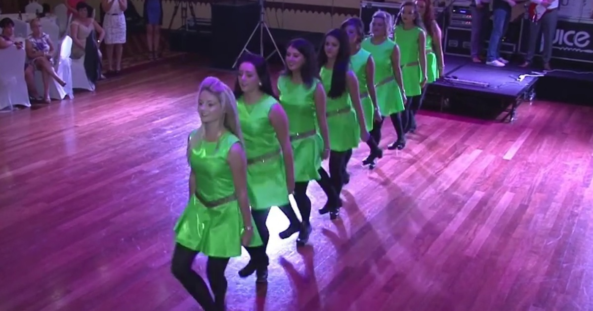 8 bridesmaids dance a traditional Irish dance, but watch what happens when the groom joins